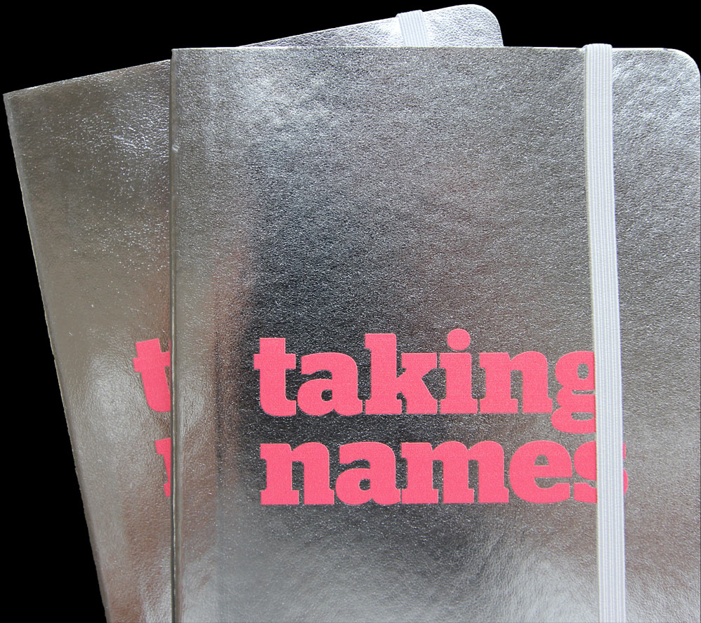 a notebook with 'taking names' written on the front
